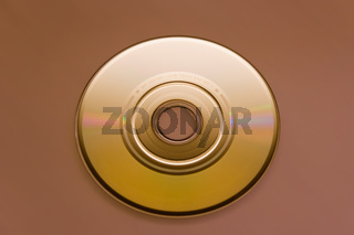 CD rom on brown background