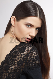 Woman with modern hairstyle in studio