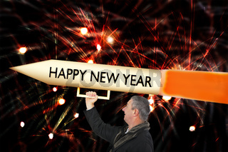Man with big New Year's Eve rocket at the turn of the year