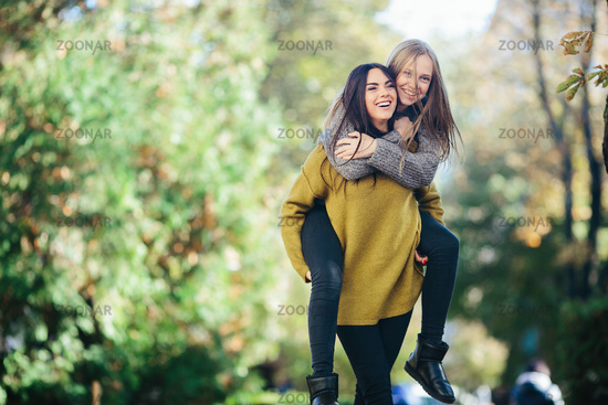 Two girls having fun in the park