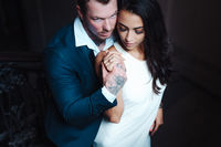 Beautiful, young couple posing on camera indoors