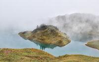 alpine lake in dense fog