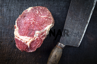 Dry aged Raw Entrecote Steak on Chopping Board