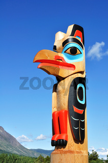 Eagle Totem Pole Against a Blue Sky located in Carcross