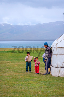 Man and kids by the yurt, Kyrgyzstan