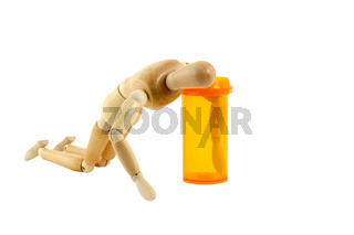Manikin with pill bottle