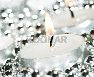 white festive candles with decoration