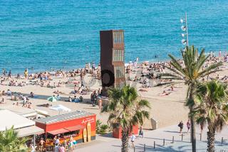 The city  beach of Barceloneta with the sculpture L'Estel Ferit in Barcelona