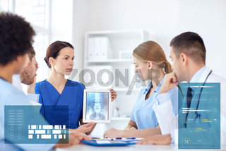 group of doctors with x-ray on tablet pc at clinic