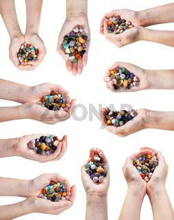set of hands with handful of various gemstones