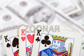 poker cards with money on the table