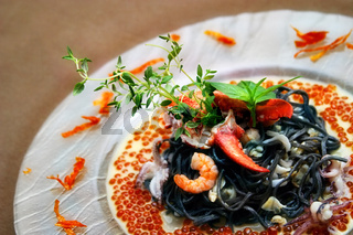 Black pasta with lobster