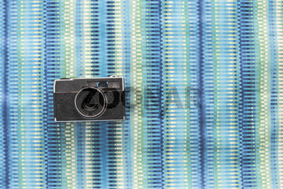 Vintage photocamera on blue background
