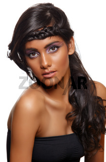 tanned woman with curly hair