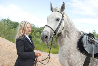 girl with horse.outdoor