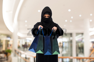 muslim woman in hijab with shopping bags