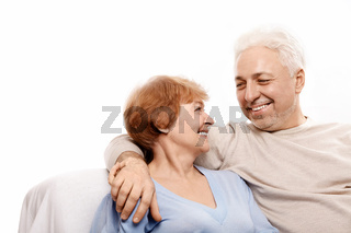 Smiling elderly pair on a white background