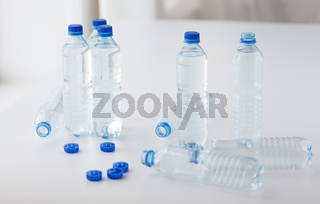 close up of bottles with drinking water on table