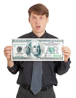 Funny stupid man holding a big money