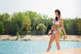 Summer beach woman walk sand wear bikini