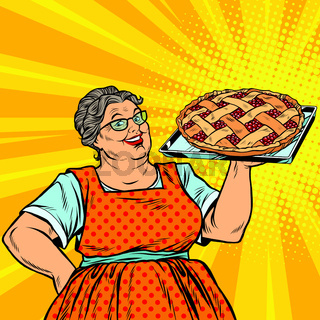 Old joyful retro woman with berry pie