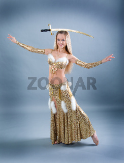 woman performing arabic dance with sabre
