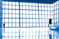 Person silhouette in glass corner of office centre