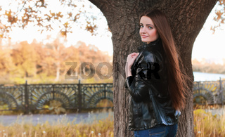 fashion young girl in autumn park
