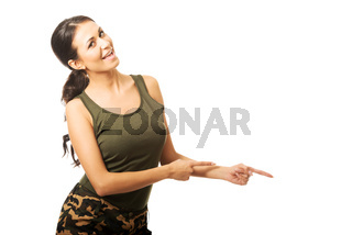 Woman in military clothes pointing to the right