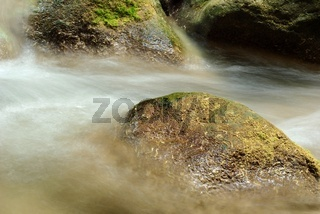 wet stones lying in the fast stream
