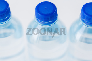 close up of plastic bottles with drinking water