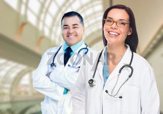 Two Doctors or Nurses Inside Hospital Building