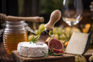 Camembert cheese on board with fig