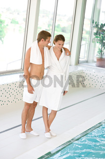 Swimming pool - young sportive couple relax