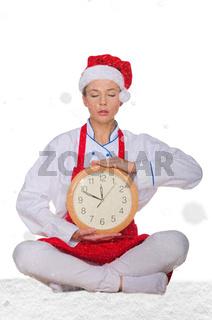 cook in Santa hat, yoga clock under snow
