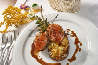 Image of lamb chops on a bed of vegetables Eggplant stuffed with vegetables
