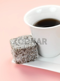 Small lamington cakes isolated against a pink background
