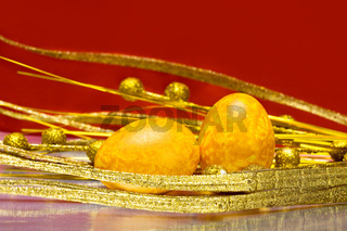 Easter eggs with golden leaves