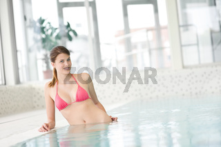 Swimming pool - beautiful woman in bikini