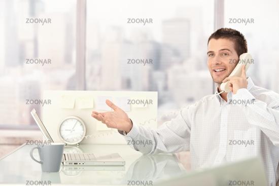 Handsome businessman chatting on phone