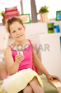 Portrait of girl with mobile phone