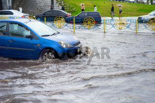 Car traffic problem. Flooded road
