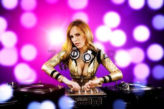 Beautiful DJ girl on decks on the party