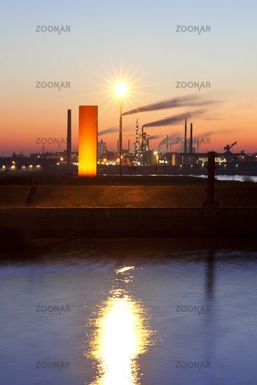 illuminated sculpture  Rhineorange at sunset in the port of Duisburg, Ruhr Area, Germany
