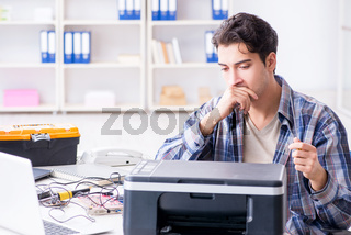 Hardware repairman repairing broken printer fax machine