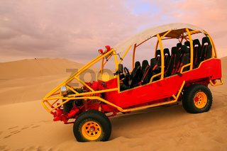 Dune buggy in a desert near Huacachina, Ica region, Peru.