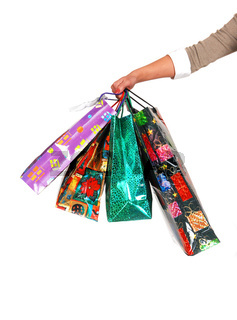 The arm of a woman with shoping bags.