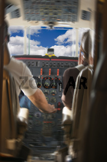 Jet Cockpit with Pilots and Clouds - motion added.