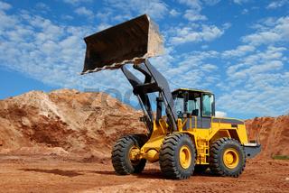 wheel loader bulldozer in sandpit