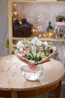 glass vase with Mixed bouquet on wood table. beautiful fresh flowers still life.